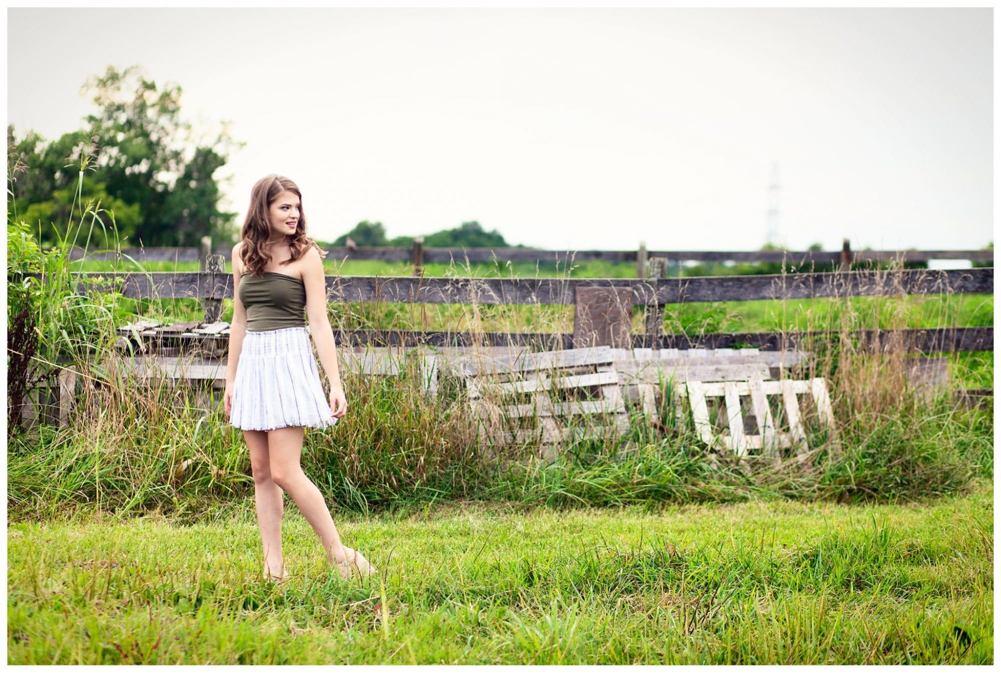 Louisville High School Senior Girl at Blackacre Nature Preserve Standing by rustic red and white trailor