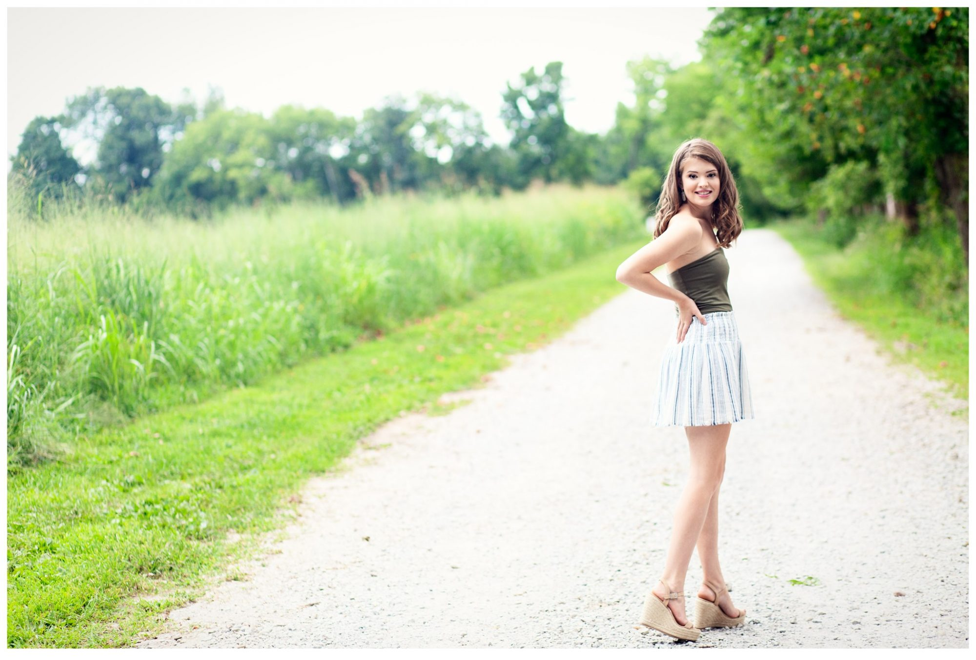 Louisville Senior Girl at Blackacre Farm standing on rustic gravel road
