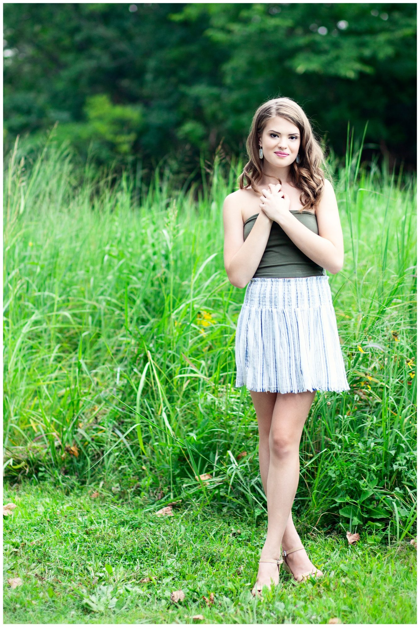 Louisville High School Senior Girl at Blackacre Farm standing in tall grass field.