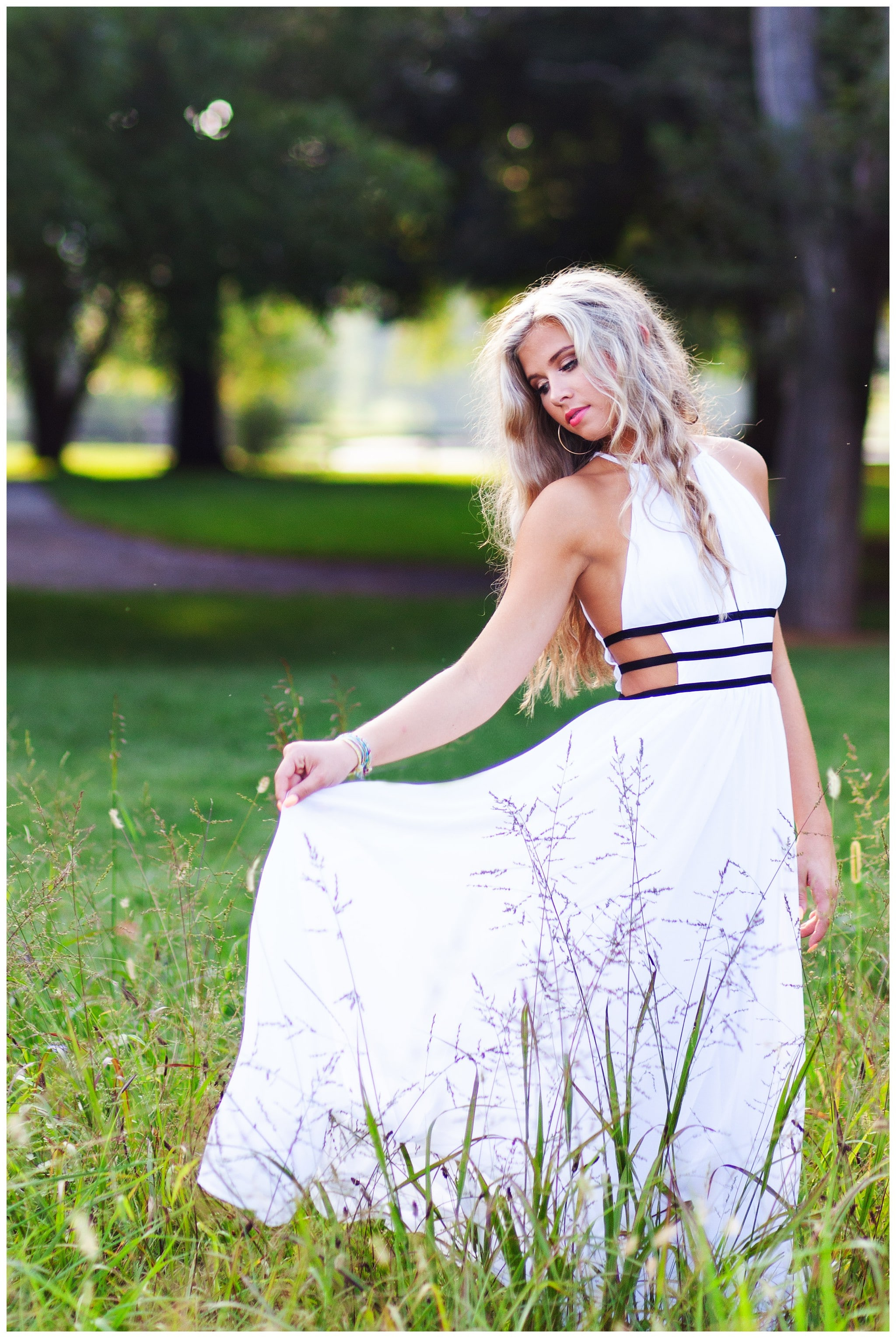 Twighlight Senior Session in Louisville KY in a beautiful field of tall grass.