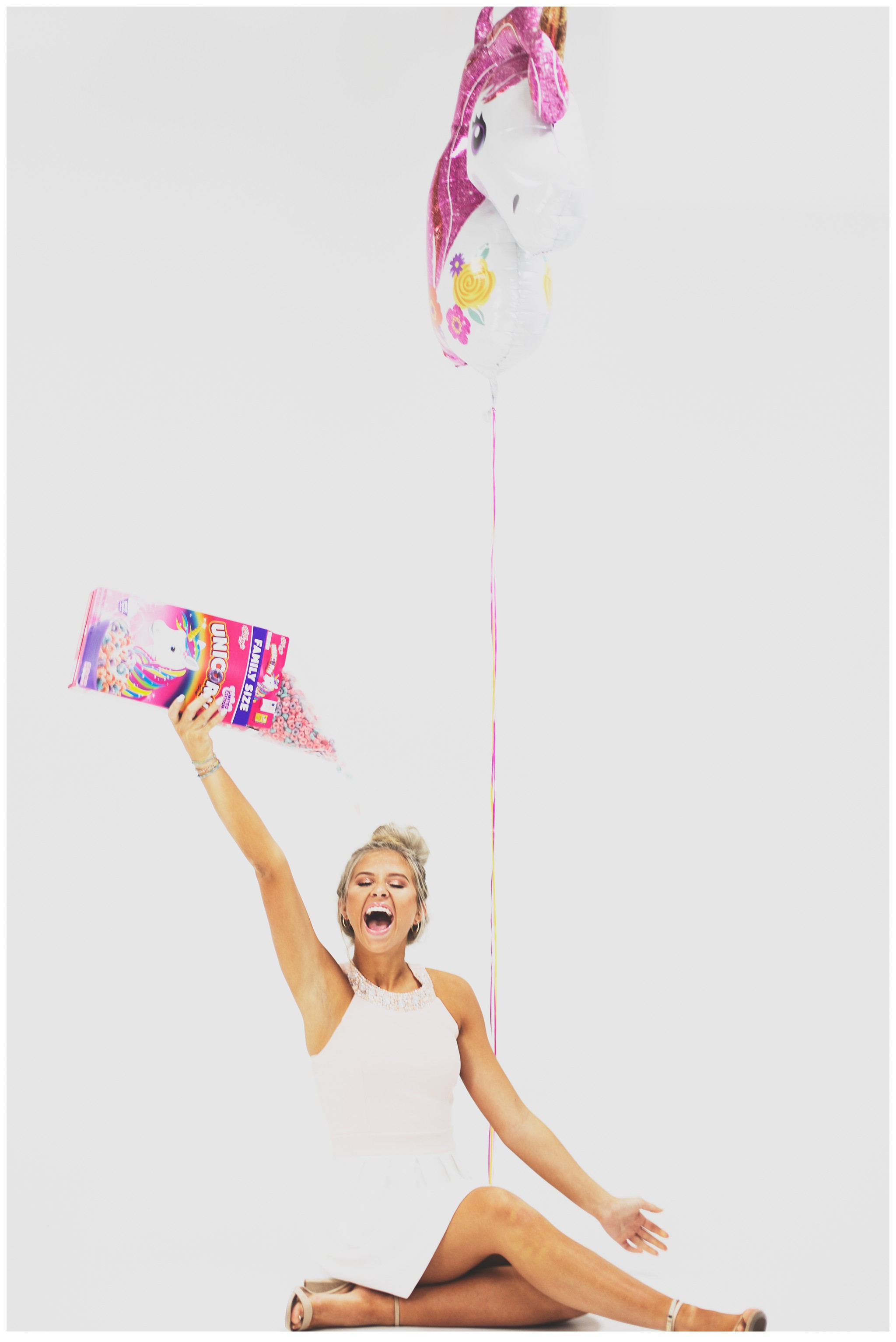 Senior Model with Unicorn Balloon and Fruity Pebbles Cereal